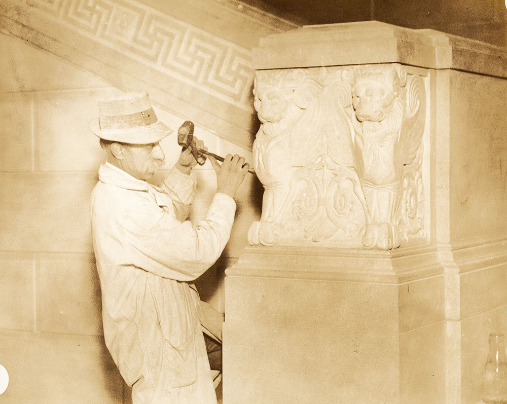 Sculptor from the John Donnelly Company carving one of the pairs of griffins on the main stairway of the Central Library of the Free Library of Philadelphia, 1926
