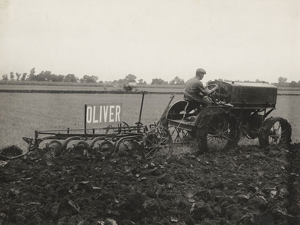 The Oliver Automatic pulled by Four Drive tractor