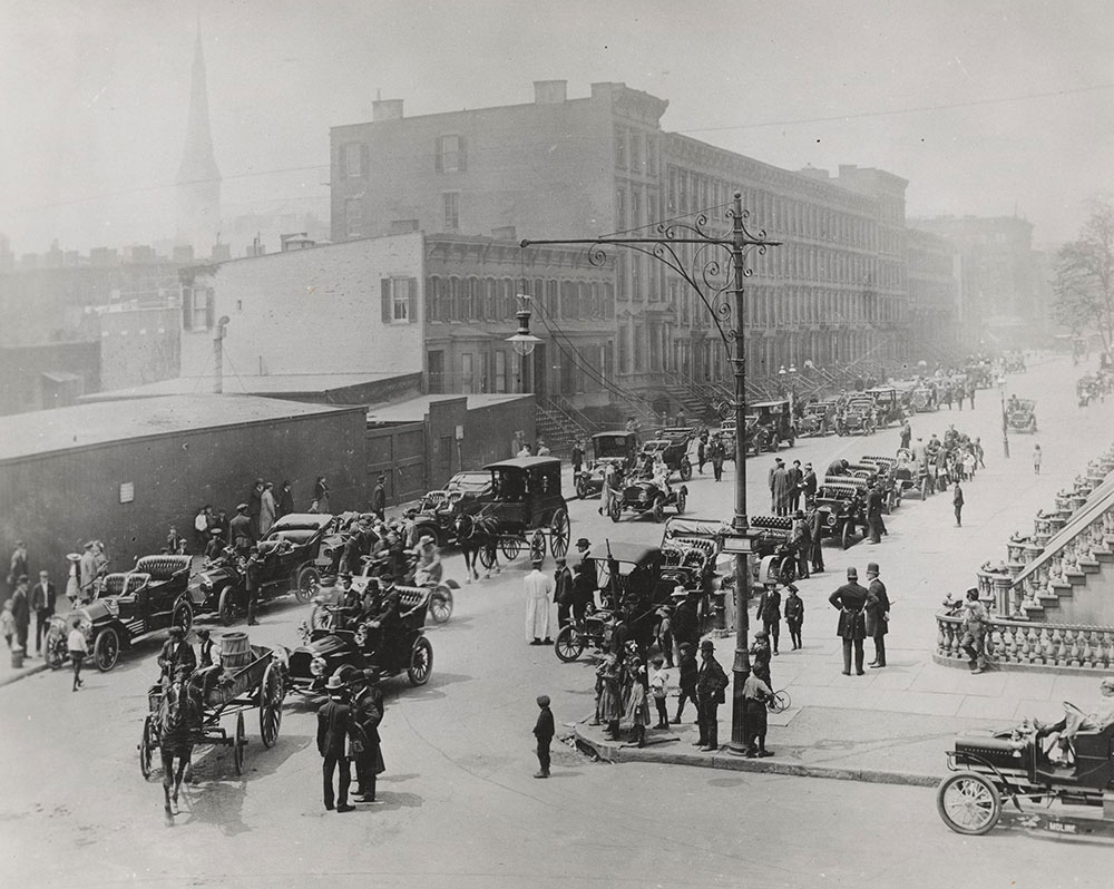 Street scene in New York City  with horses and horseless carriages