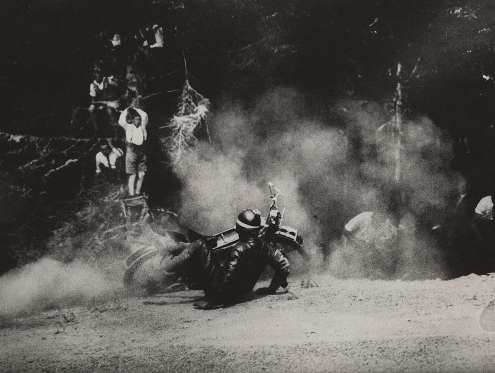 Motorcycle racer spills