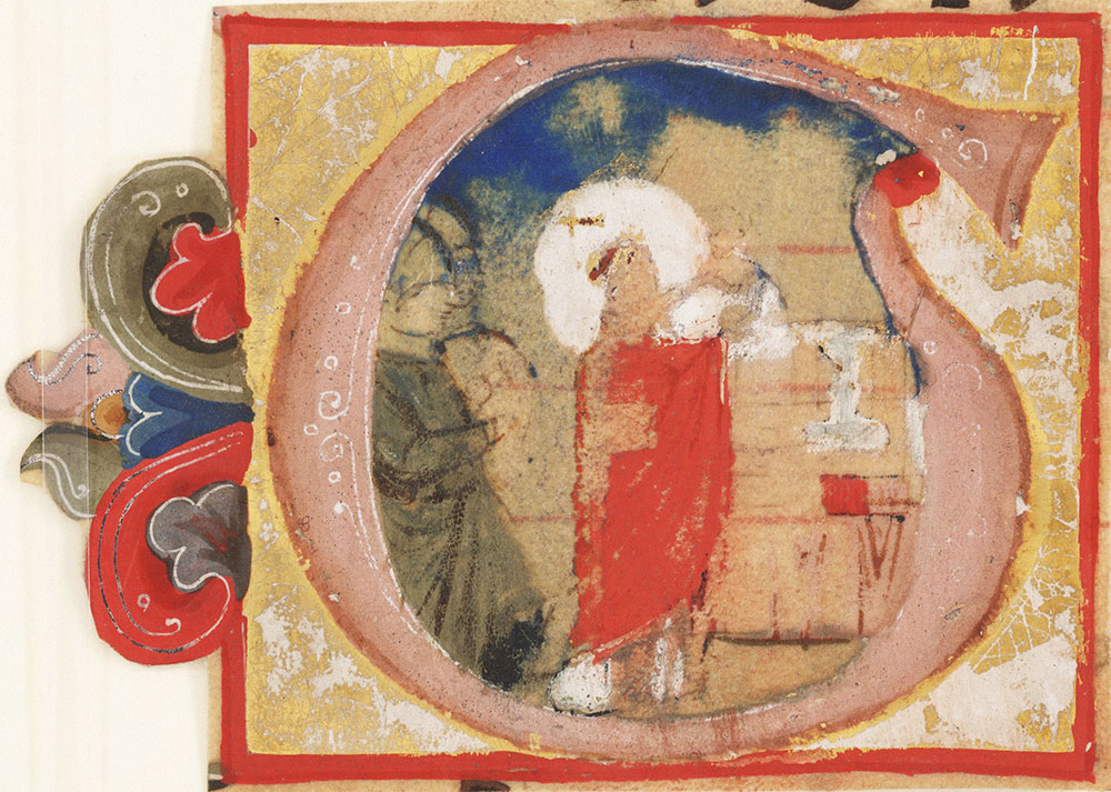 [Initial G with a priest celebrating the Eucharist]