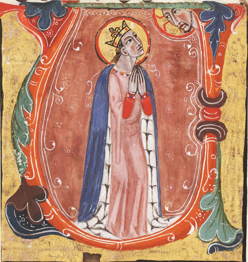 [Historiated initial U with female saint]