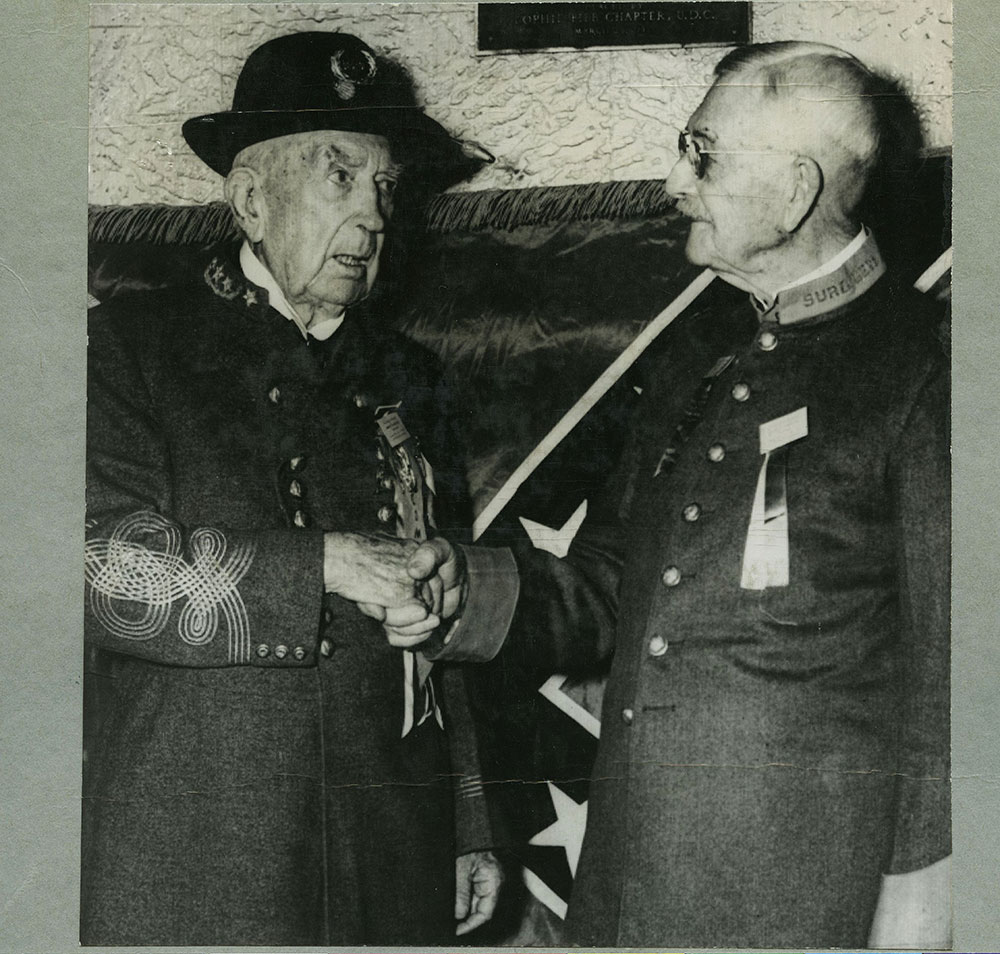 General Moore Congratulated by Dr. W.H. Scudder.