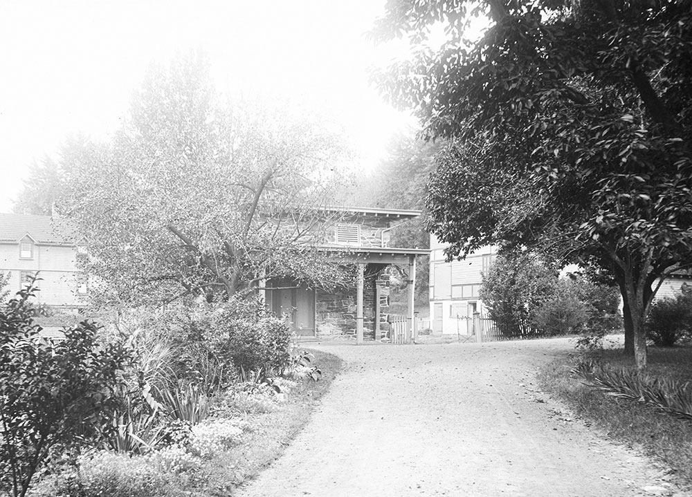 Looking towards Coach-House, showing Gardner's Cottage and Barn,
