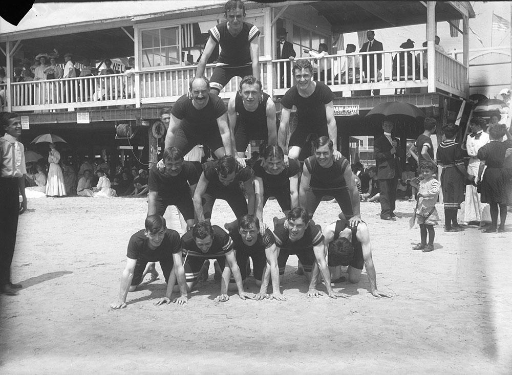 The boys in pyramid on the beach