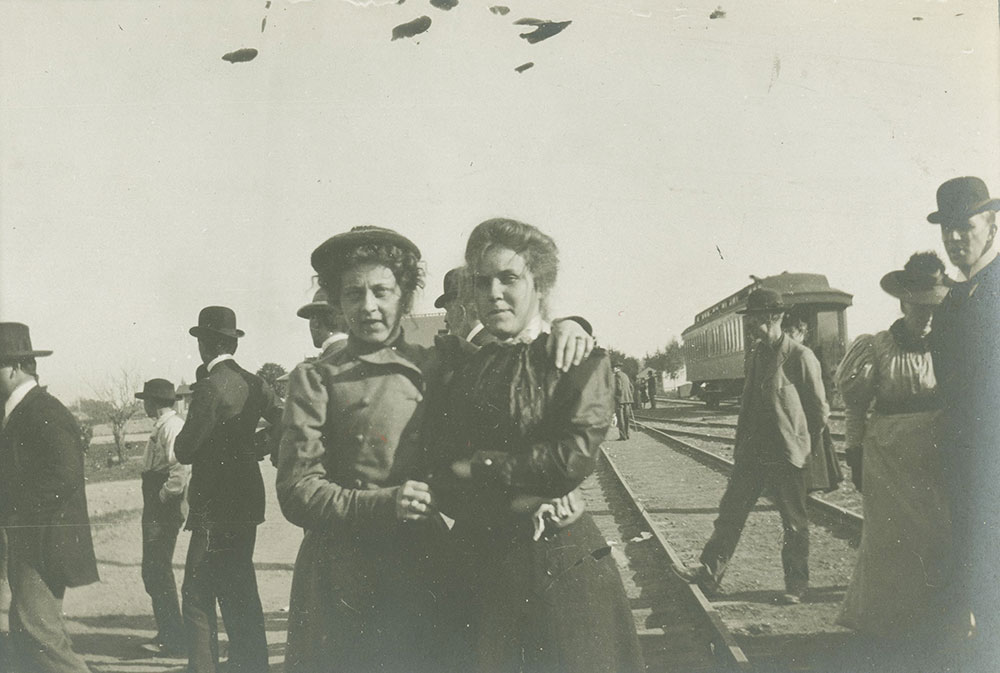 Two women and train