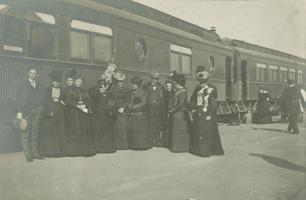 Ladies and Gentlemen in front of train