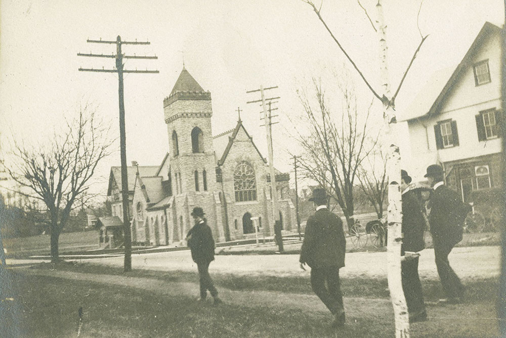 Men passing Church