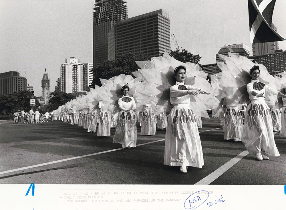 The women's division of the NSA (Nichiren Shoshu Soka Bokkai of America) Buddhist chorus parade down the Ben Franklin Parkway