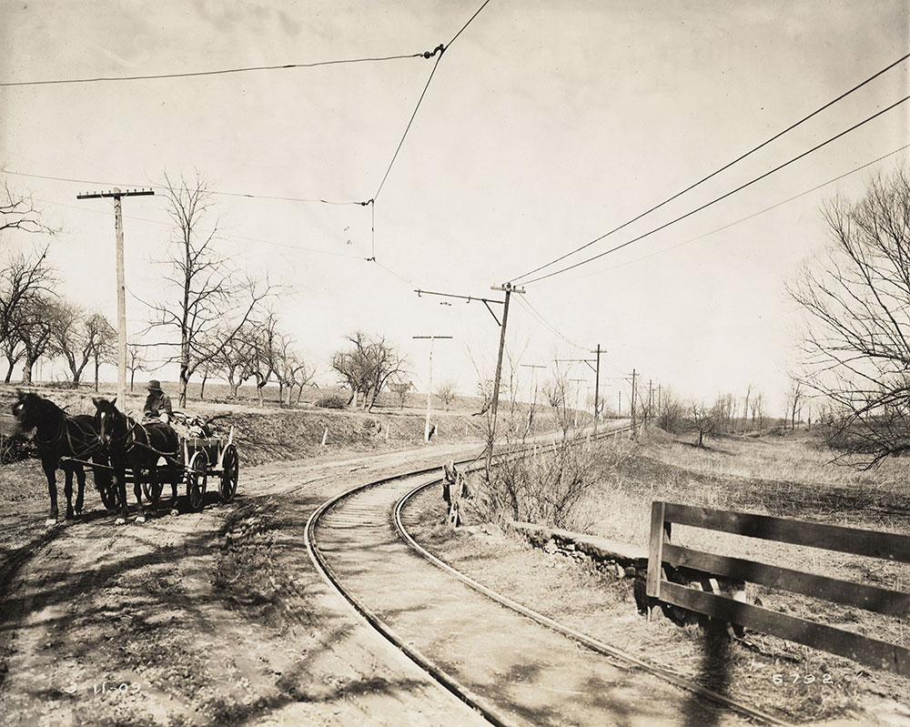 Horses and cart on trolley tracks