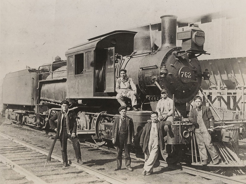 Steam train and workers